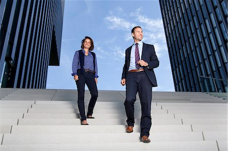 Businessman and businesswoman walking on stairs Stock Photo - Rights-Managed, Code: 853-06441702