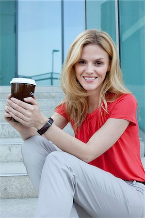 Blond woman with coffee to go on stairs Stock Photo - Rights-Managed, Code: 853-06441760
