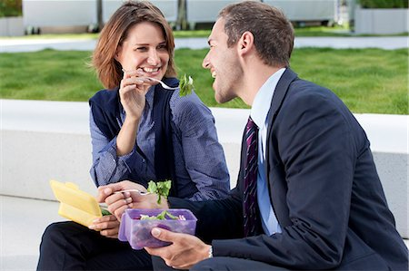 Businessman and businesswoman eating on stairs Stock Photo - Rights-Managed, Code: 853-06441798