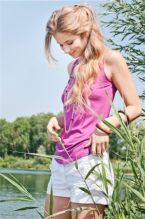 Blond young woman at a lake Stock Photo - Rights-Managed, Code: 853-06442055