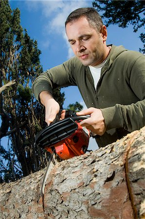 forestry - Man sawing log Stock Photo - Rights-Managed, Code: 853-06623202