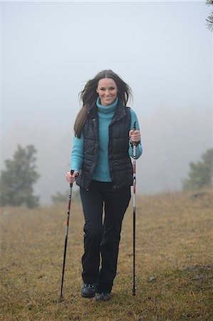 Brunette young woman Nordic walking Stock Photo - Rights-Managed, Code: 853-06623256