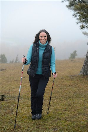 Brunette young woman Nordic walking Stock Photo - Rights-Managed, Code: 853-06623257