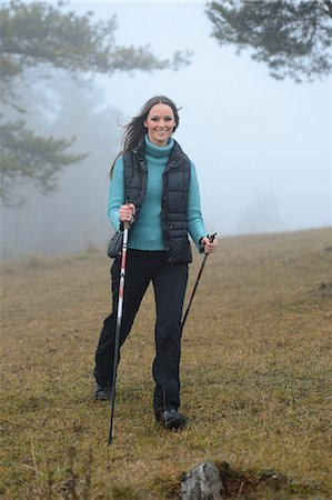 Brunette young woman Nordic walking Stock Photo - Rights-Managed, Code: 853-06623258