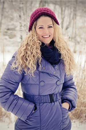 Blond woman wearing winther clothes outdoors Stock Photo - Rights-Managed, Code: 853-06623278