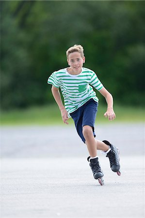 roller skate - Boy with in-line skates on a sports place Stock Photo - Rights-Managed, Code: 853-07148590