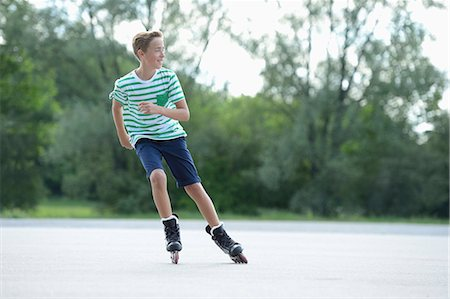 roller skate - Boy with in-line skates on a sports place Stock Photo - Rights-Managed, Code: 853-07148591