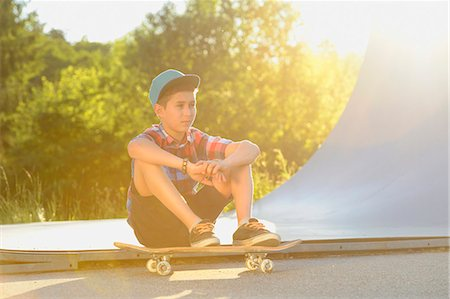 Boy with skateboard in a skatepark Stock Photo - Rights-Managed, Code: 853-07148604