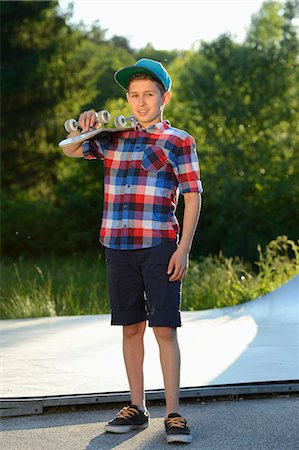 preteen touch - Boy with skateboard in a skatepark Stock Photo - Rights-Managed, Code: 853-07148608