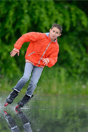 roller skate - Boy with in-line skates on a rainy day Stock Photo - Rights-Managed, Code: 853-07148623
