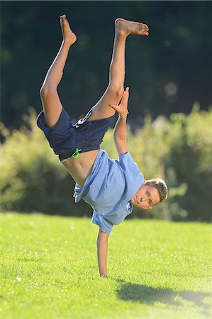 Teenager doing a handstand, Upper Palatinate, Bavaria, Germany, Europe Stock Photo - Rights-Managed, Code: 853-07241758