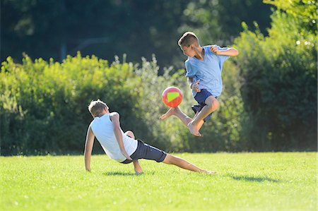 Two teenage boys playing football on a meadow, Upper Palatinate, Bavaria, Germany, Europe Stock Photo - Rights-Managed, Code: 853-07241767