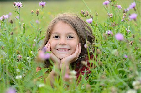 smiling - Girl lying in a meadow Stock Photo - Rights-Managed, Code: 853-07241829