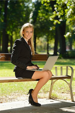 Young blond business woman with laptop in a park Stock Photo - Rights-Managed, Code: 853-07241820