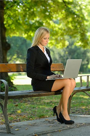 people sitting on bench - Young blond business woman with laptop in a park Stock Photo - Rights-Managed, Code: 853-07241822