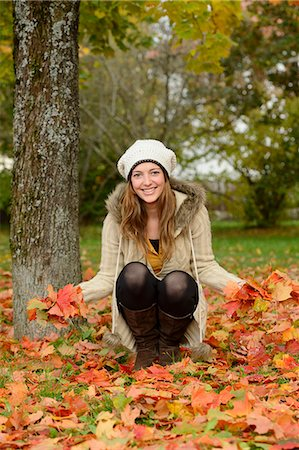 Smiling young woman at a tree in autumn Stock Photo - Rights-Managed, Code: 853-07241887