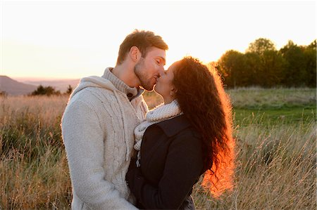 Couple kissing on field in autumn Stock Photo - Rights-Managed, Code: 853-07241956