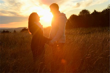 Couple at sunset on field Stock Photo - Rights-Managed, Code: 853-07241958