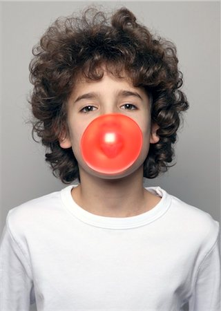 Boy making chewing gum bubble Stock Photo - Rights-Managed, Code: 853-02914074