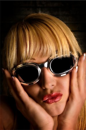 Young woman with sunglasses, portrait Stock Photo - Rights-Managed, Code: 853-02914229