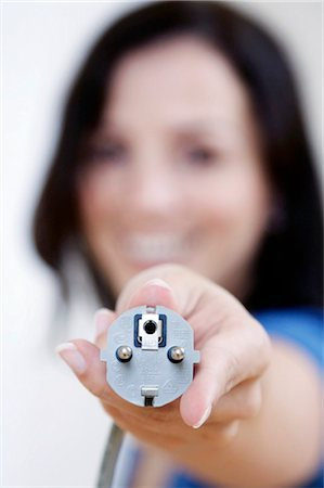 woman holding a plug, portrait Stock Photo - Rights-Managed, Code: 853-02914258