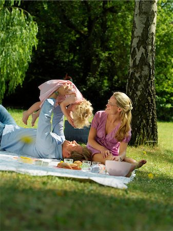 family fun day background - Family having picnic in park Stock Photo - Rights-Managed, Code: 853-02914295