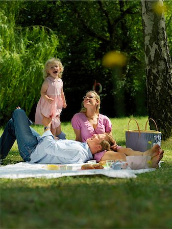 family fun day background - Family having picnic in park Stock Photo - Rights-Managed, Code: 853-02914298