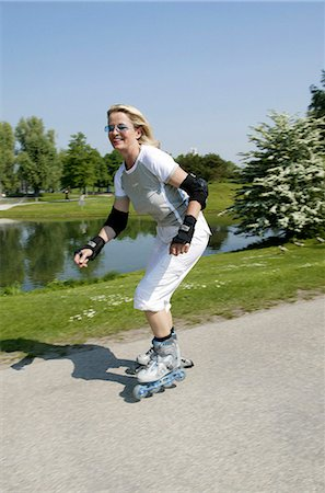 roller skate - Senior woman inline skating, high size Stock Photo - Rights-Managed, Code: 853-03458834