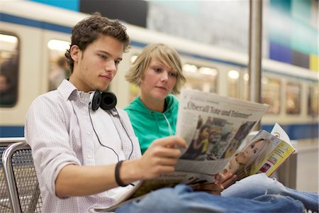 Teenager couple readung newspaper at underground, horizontal format Stock Photo - Rights-Managed, Code: 853-03458853