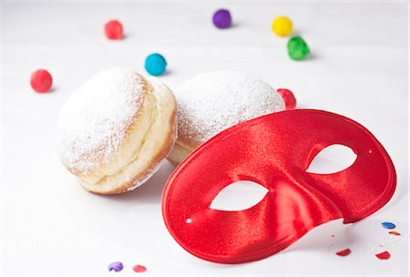 Red carnival mask, doughnuts and confetti, close-up Stock Photo - Rights-Managed, Code: 853-03458965