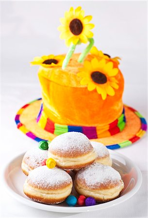 Doughnuts on a plate in front of a colourful hat, high angle view Stock Photo - Rights-Managed, Code: 853-03458966