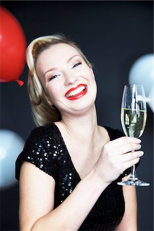 Woman holding champagne glass Stock Photo - Rights-Managed, Code: 853-03459142