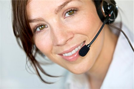Smiling woman wearing headset, portrait Stock Photo - Rights-Managed, Code: 853-03616809