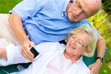 Happy senior couple with smartphone in garden Stock Photo - Rights-Managed, Code: 853-03616964