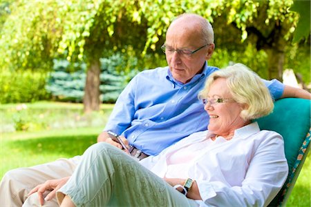 Happy senior couple with smartphone in garden Stock Photo - Rights-Managed, Code: 853-03616965