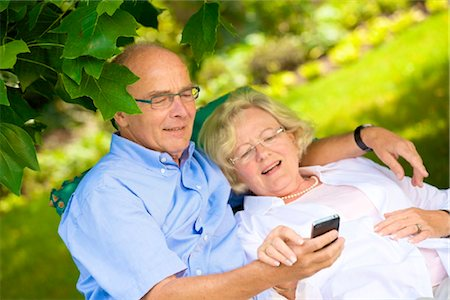 Happy senior couple with smartphone in garden Stock Photo - Rights-Managed, Code: 853-03616966