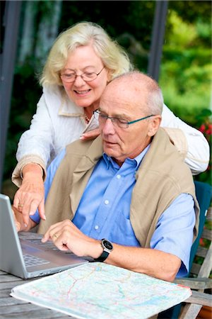 Senior couple on terrace with laptop and road map Stock Photo - Rights-Managed, Code: 853-03616988