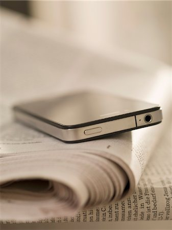 Smartphone and newspaper Stock Photo - Rights-Managed, Code: 853-03776335