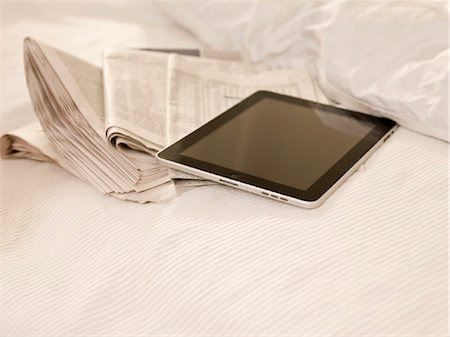 Tablet PC and newspaper Stock Photo - Rights-Managed, Code: 853-03776336