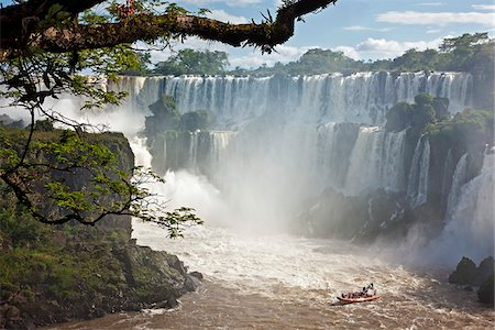 people in argentina - An inflatable boat takes visitors into white water at the bottom of one of the spectacular Iguazu Falls of the Iguazu National Park, a World Heritage Site. Argentina Stock Photo - Rights-Managed, Code: 862-05996711
