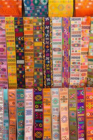 Bhutanese fabric belts used to secure a lady's kira around her waist, hanging up for sale in a shop. Stock Photo - Rights-Managed, Code: 862-05997051