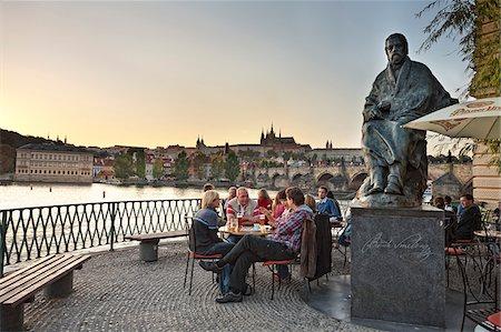 european cafe bar - Europe, Czech Republic, Central Bohemia Region, Prague. Riverside Cafe and statue of composer Smetana, overlooking the Vltava Moldau River Stock Photo - Rights-Managed, Code: 862-05997417