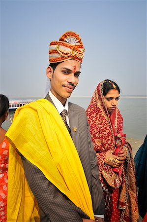 The grooms in a marriage on the banks of the Ganges river. Varanasi, India Stock Photo - Rights-Managed, Code: 862-05997891