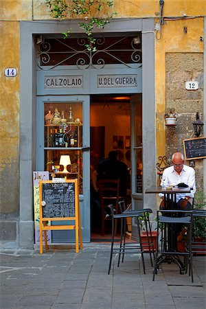 european cafe bar - Italy, Tuscany, Lucca. A man outside a typical cafe Stock Photo - Rights-Managed, Code: 862-05997962