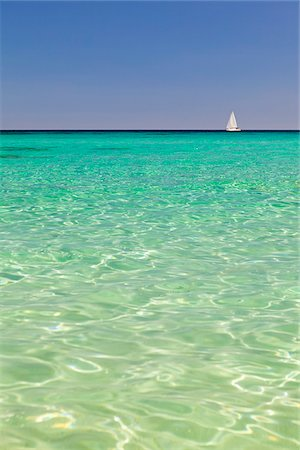 Italy, Sardinia, Olbia-Tempo, Berchidda. A sailing boat out at sea. Stock Photo - Rights-Managed, Code: 862-05998248