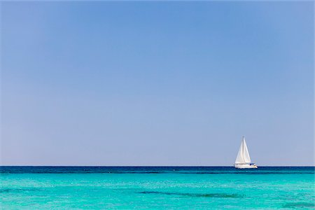 Italy, Sardinia, Olbia-Tempo, Berchidda. A sailing boat out at sea. Stock Photo - Rights-Managed, Code: 862-05998249