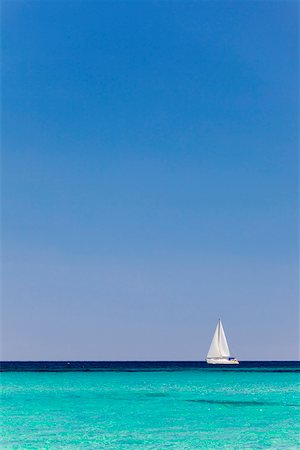 Italy, Sardinia, Olbia-Tempo, Berchidda. A sailing boat out at sea. Stock Photo - Rights-Managed, Code: 862-05998250
