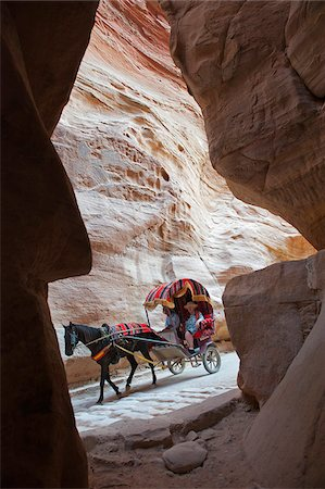 Horse drawn carriage travelling through The Siq, a narrow canyon passage leading to The Treasuary, Petra Stock Photo - Rights-Managed, Code: 862-05998318