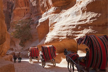 Horse drawn carriage travelling through The Siq, a narrow canyon passage leading to The Treasuary, Petra Stock Photo - Rights-Managed, Code: 862-05998331