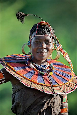 A Pokot woman in traditional dress. Her leather skirt is made from tanned goatskins. Stock Photo - Rights-Managed, Code: 862-05998517